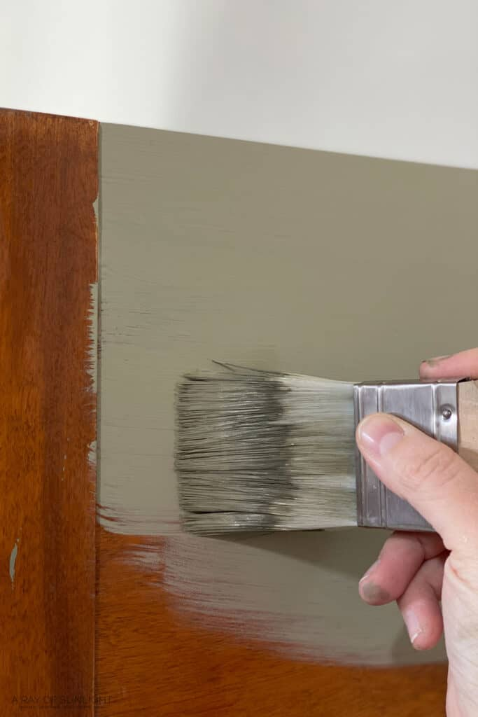 brusing chalk paint on tables with zibra paint brush