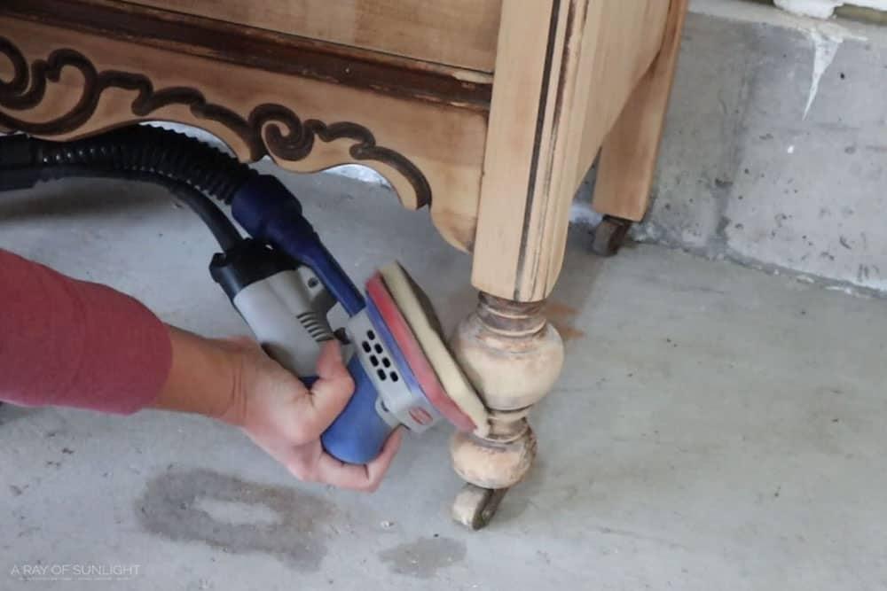 using the surfprep sander to sand the turned wood legs