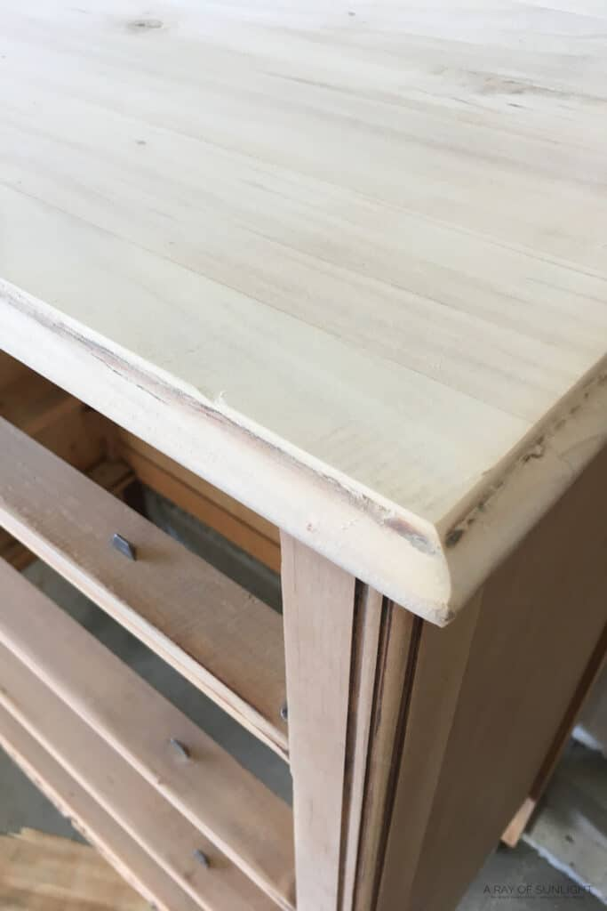 closeup of dresser after sanded. Some stain left in the details.