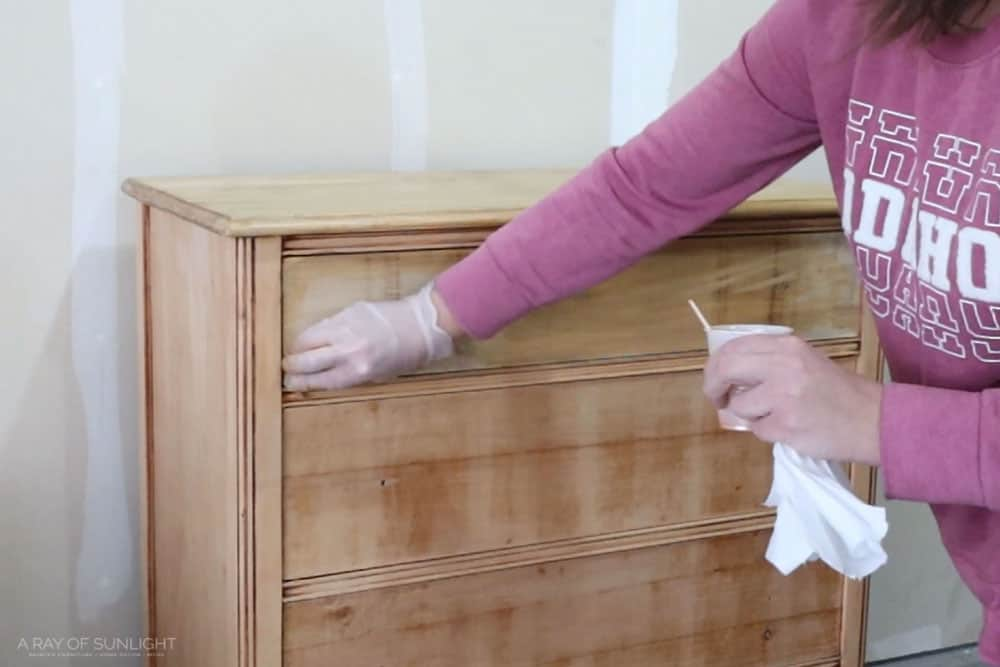 staining the top drawer with orange stain