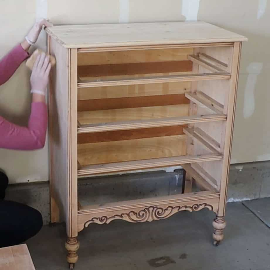 using a tack cloth to get the dust off of the dresser