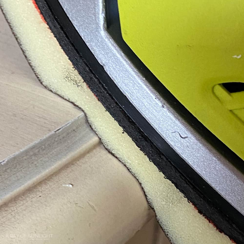 closeup of sanding pad on curves of furniture