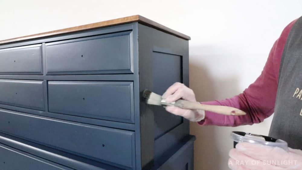 Brushing the glaze on with a paintbrush