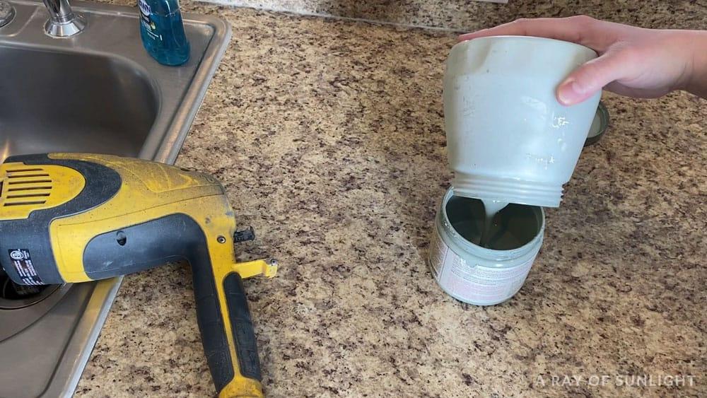 empty paint sprayer container