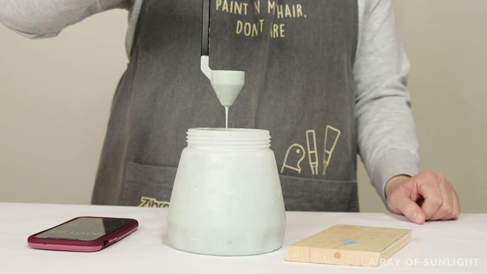 paint draining through viscosity cup