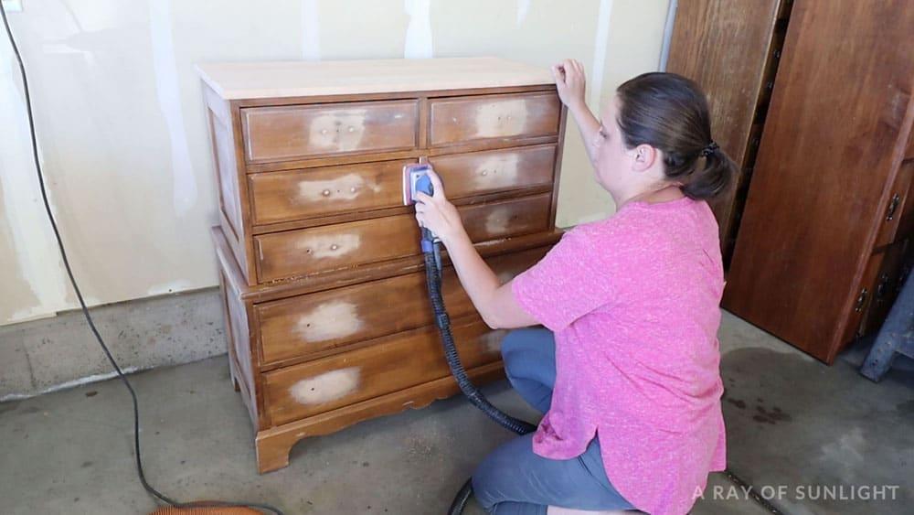 Sanding the dresser with a SurfPrep sander