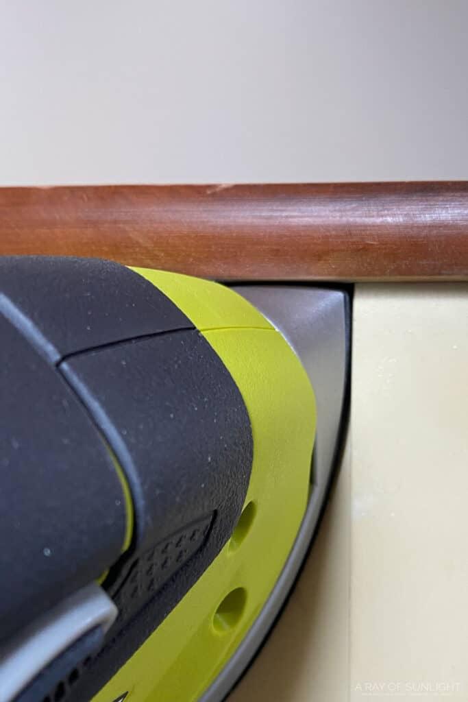 ryobi detail sander in the corner