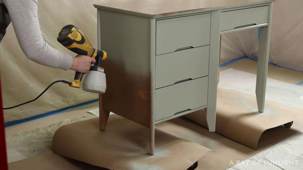 spraying furniture with a wagner double duty paint sprayer and chalk paint