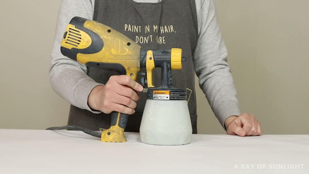 holding wagner double duty paint sprayer