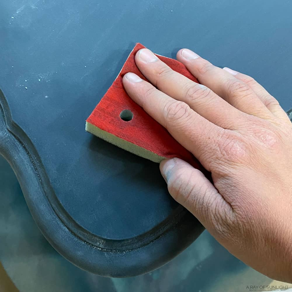 Lightly sanding the top coat with a very fine SurfPrep sanding pad