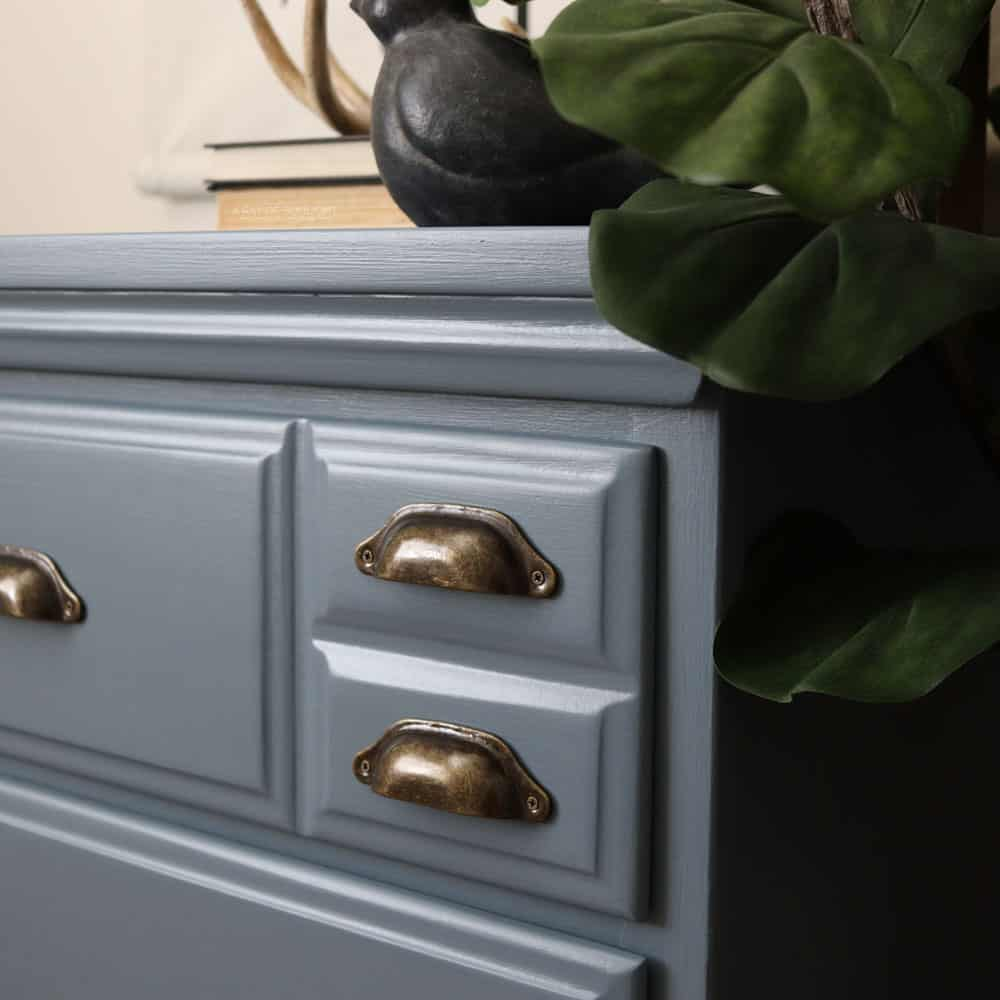 Top side view of blue chalk painted dresser.