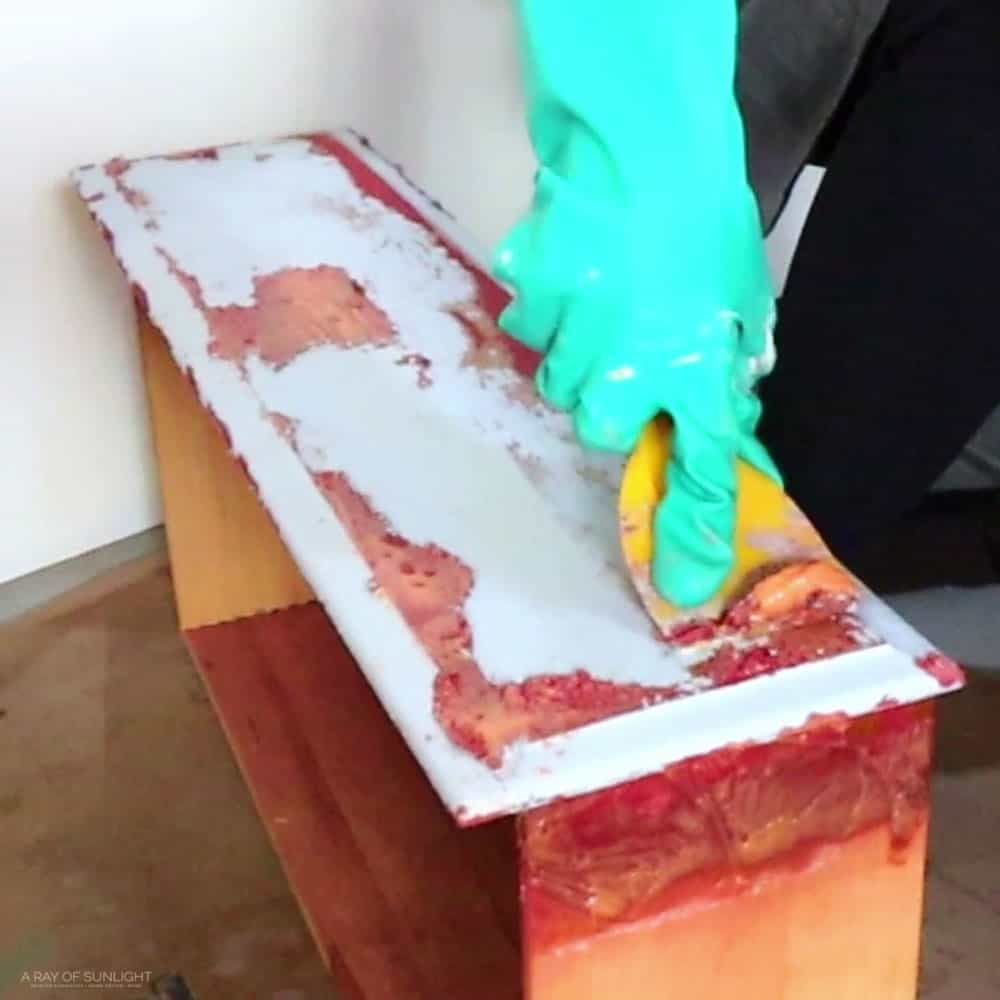 scraping off the first layer of paint on the drawer