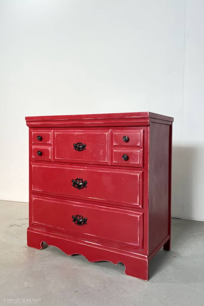 Old red dresser before the makeover