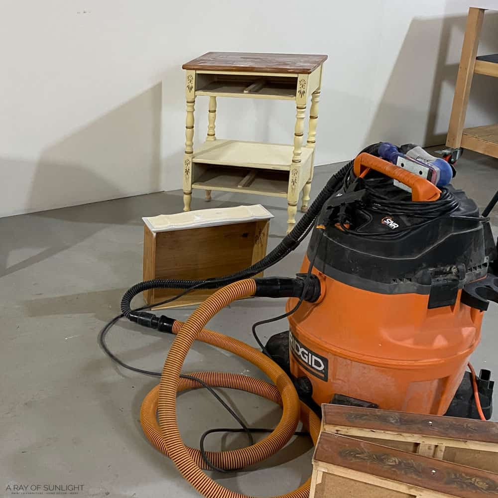 preparing furniture for paint by scuff sanding and vacuuming
