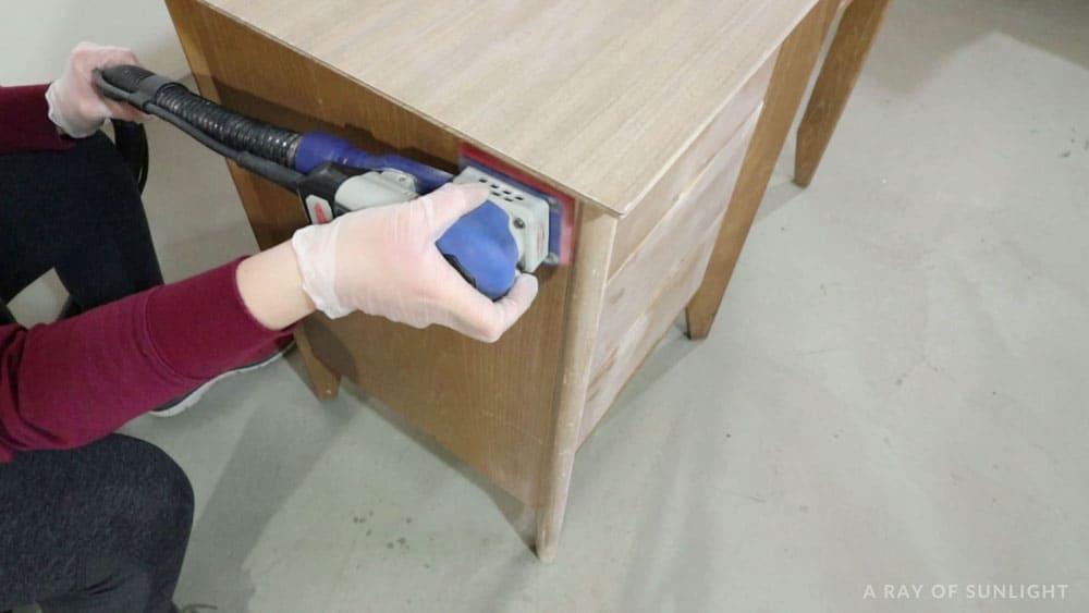 scuff sanding the desk with a surfprep sander