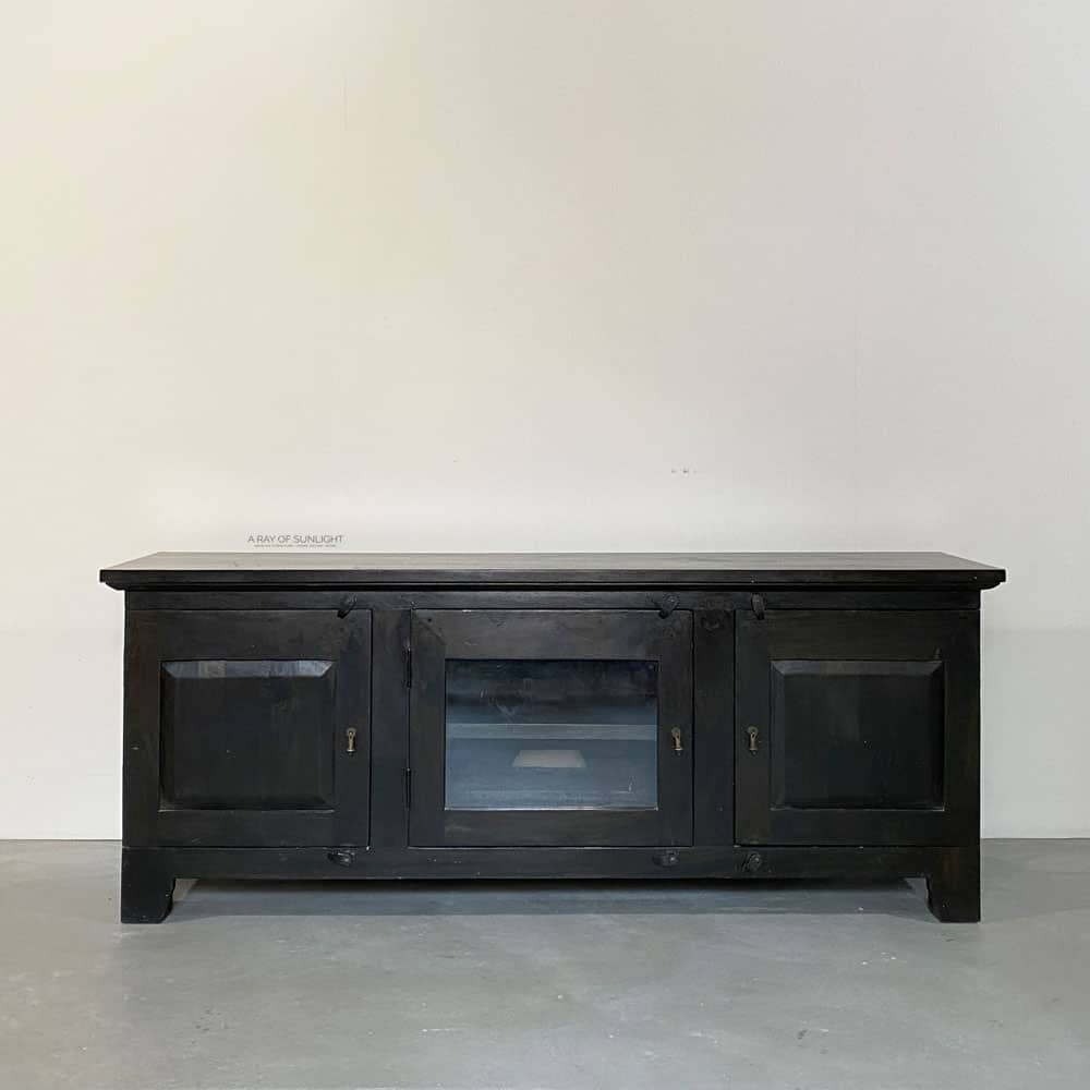 Black tv stand before white paint makeover