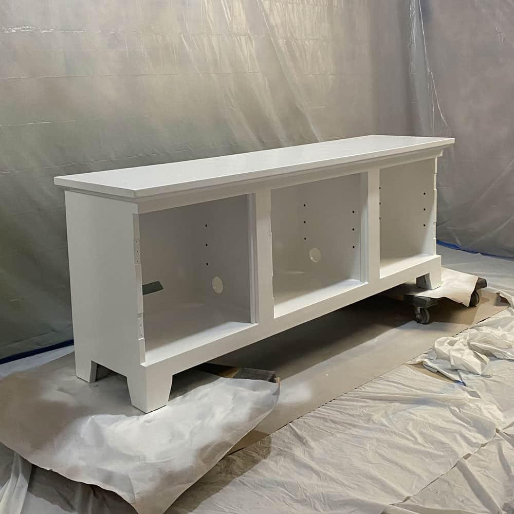 Painting dark wood white.