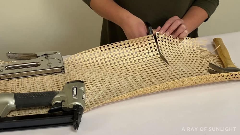 cutting cane webbing with scissors