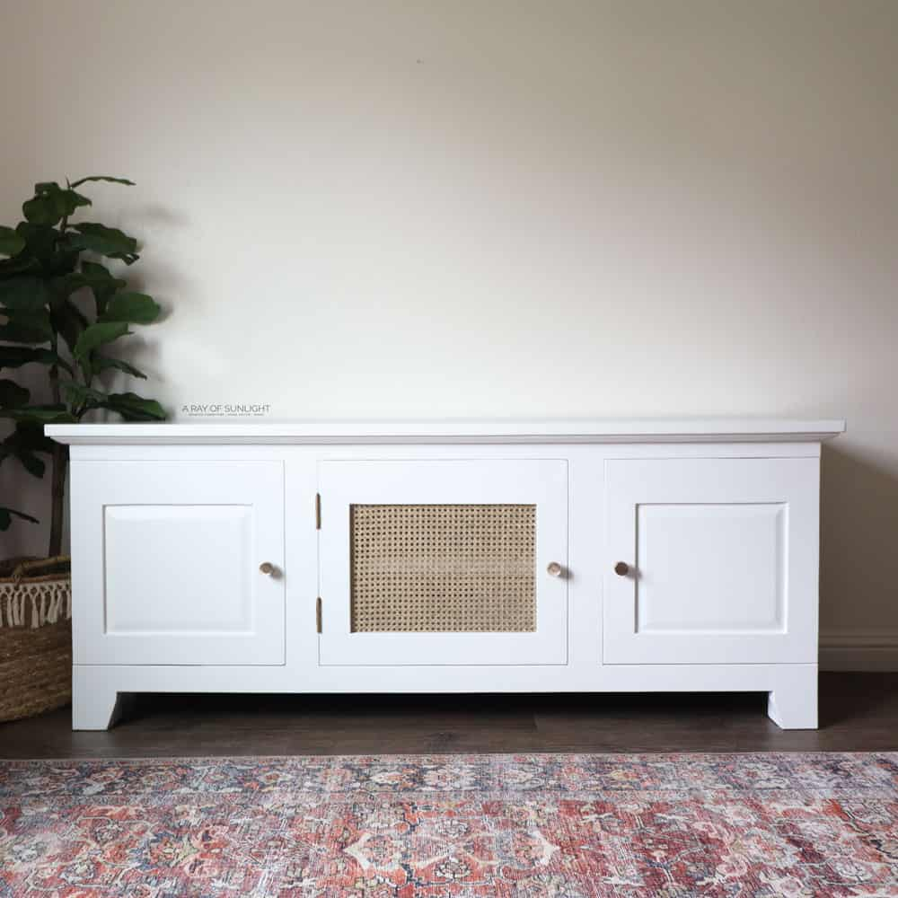 diy white painted tv stand with cane in the middle door