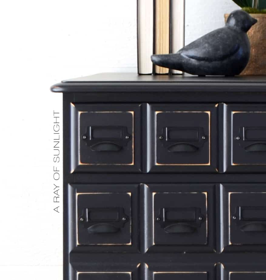 closeup of apothecary nightstand drawers with card catalog pulls