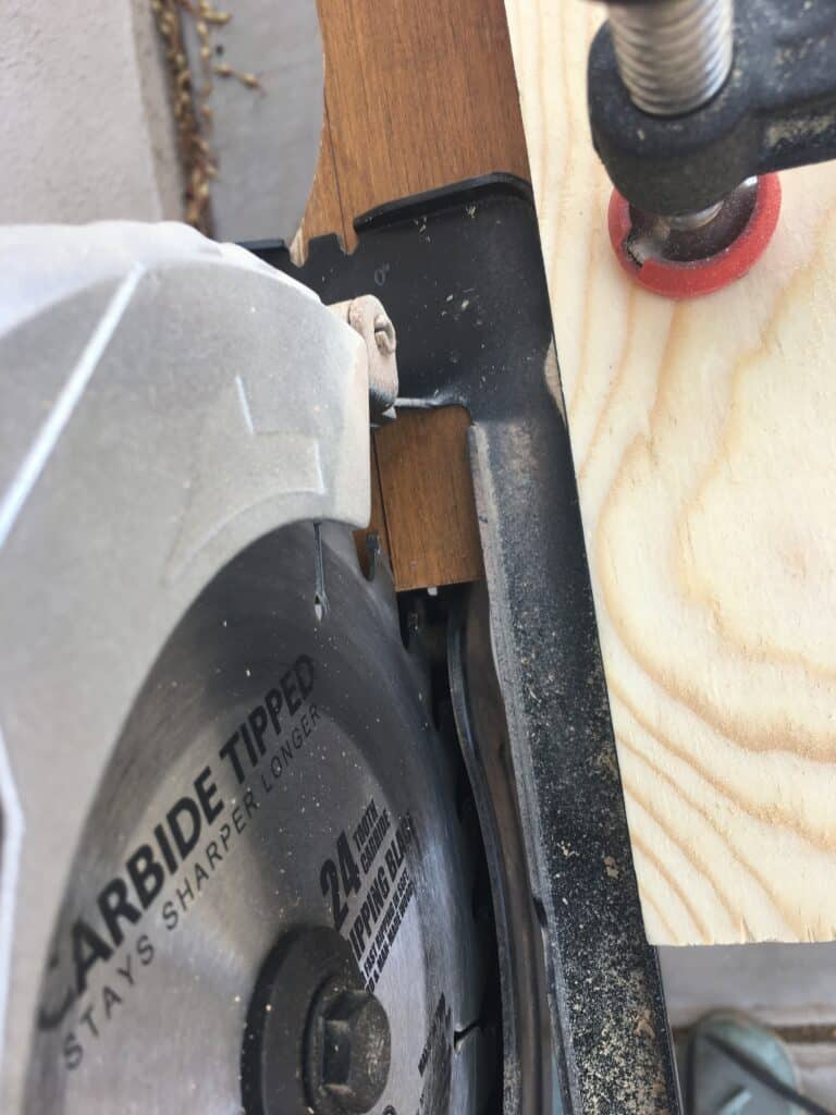 cutting the bottom of the nightstand with a circular saw