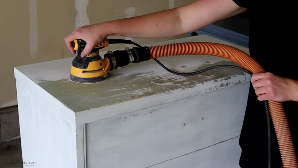 sanding off the old paint with orbital sander