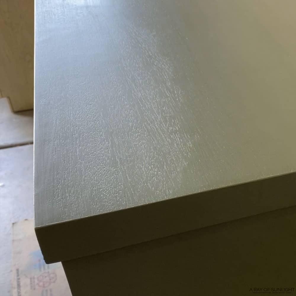 wood grain showing through paint