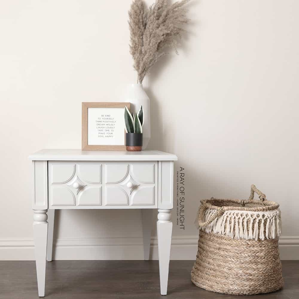 end table painted in seagull gray with white knobs - front view