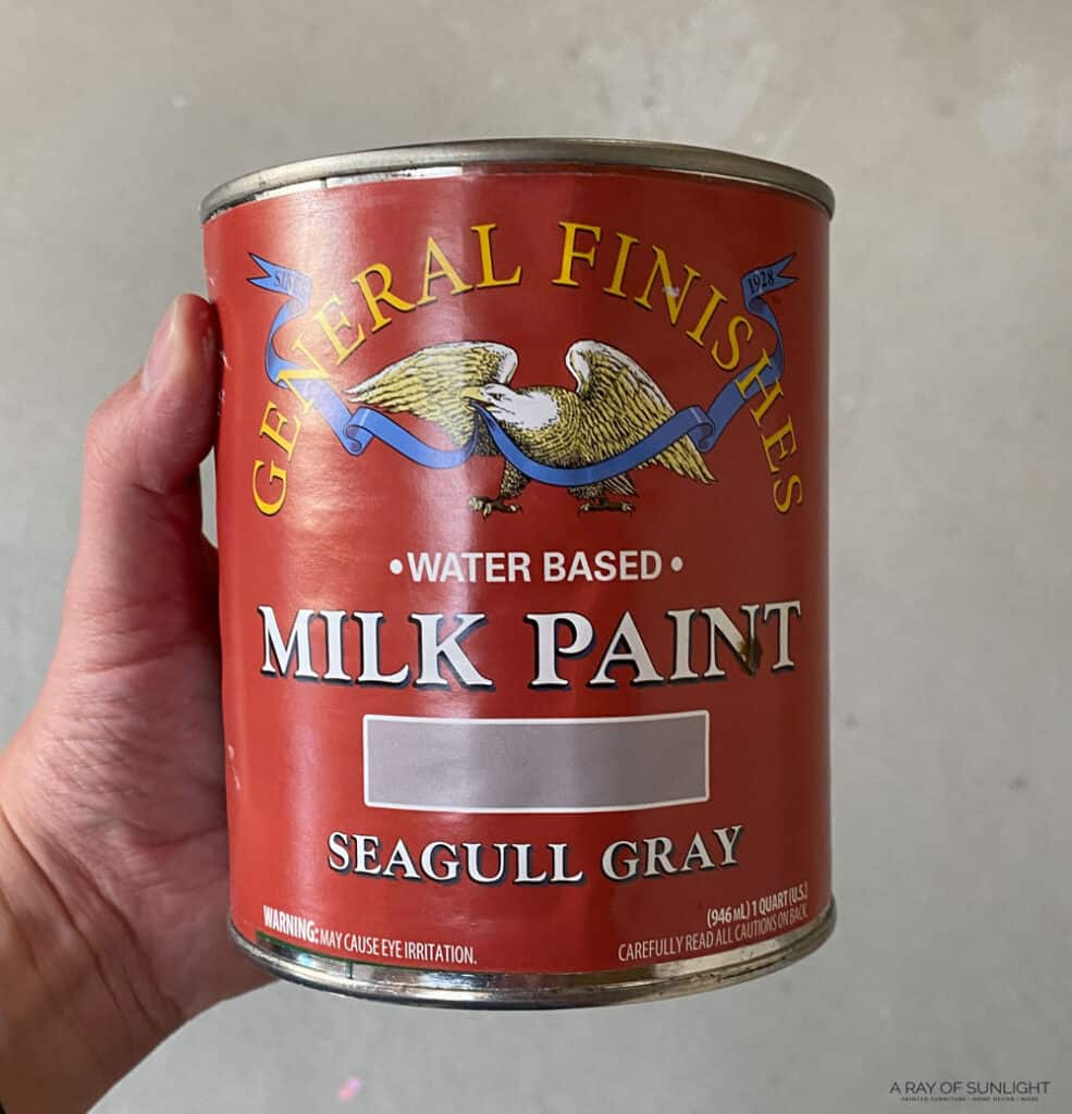 a can of general finishes milk paint in seagull gray