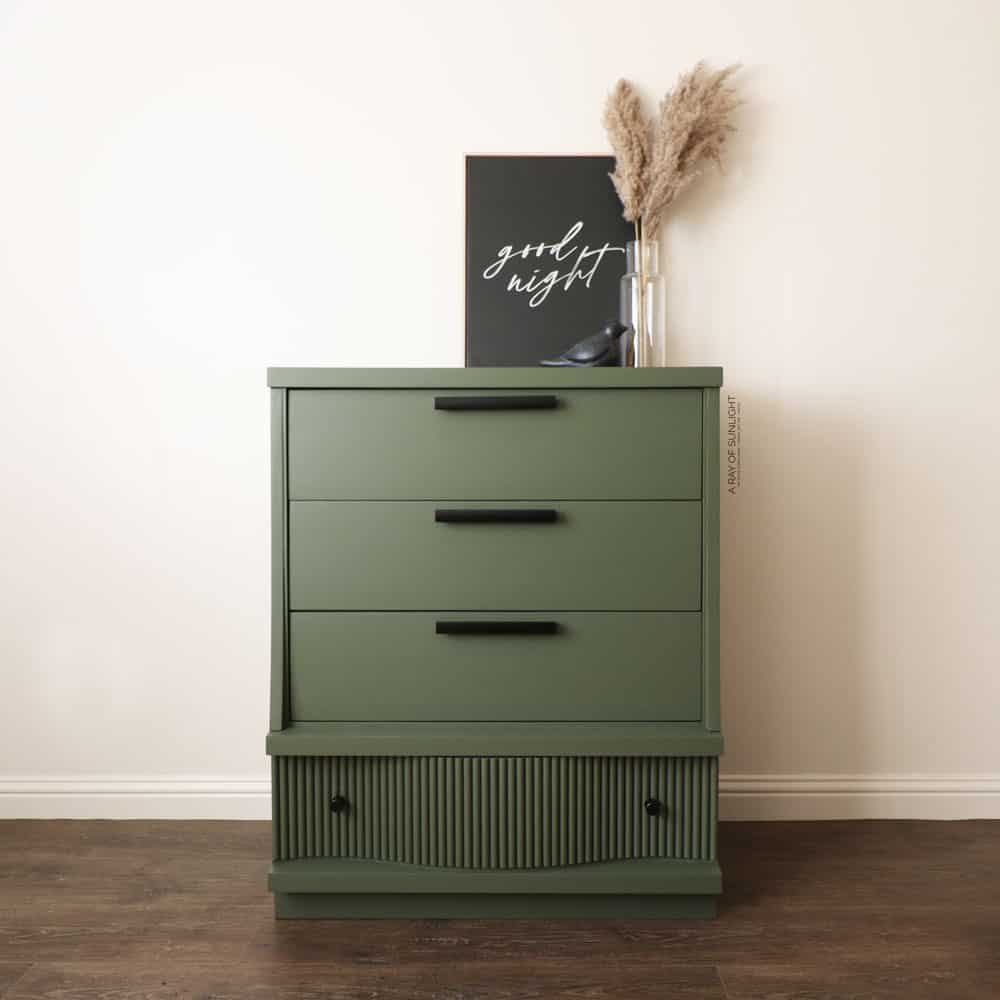 green painted diy fluted dresser with bottom curvy drawer that has half round dowels glued onto it to create ribbed look