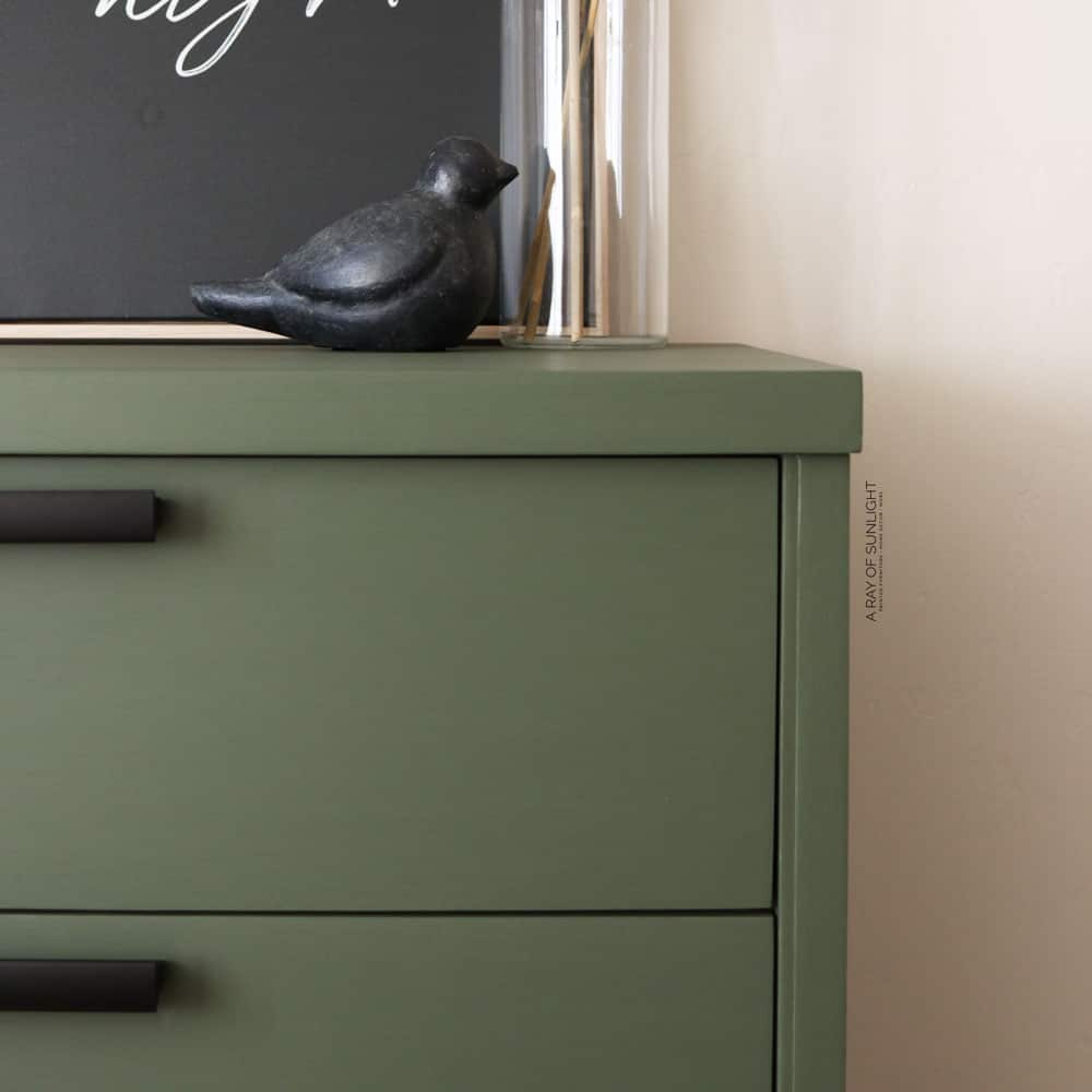 closeup of green painted art deco dresser in fusion mineral paint