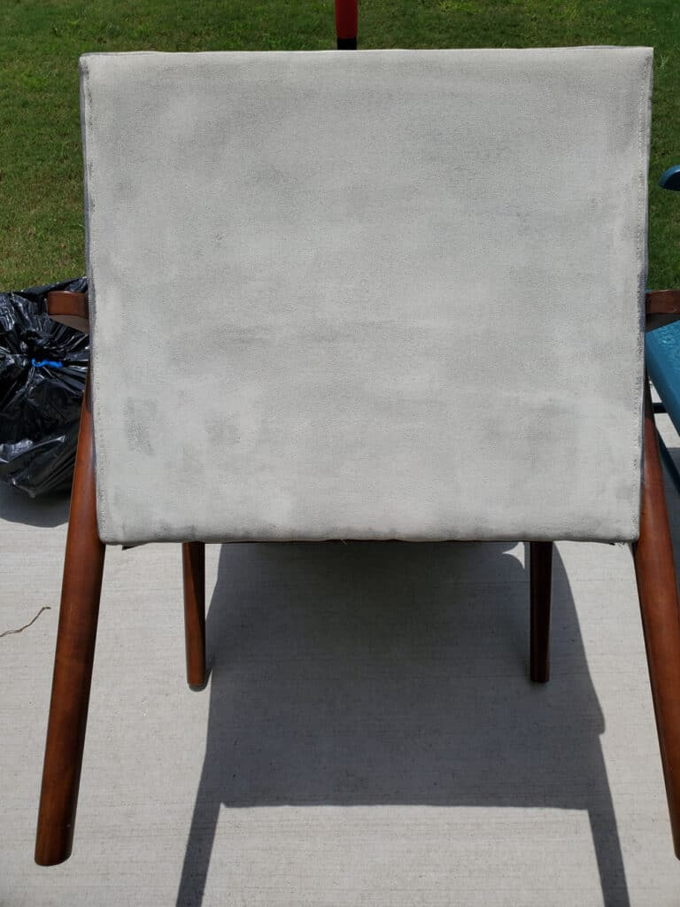 One coat of paint on fabric chair.