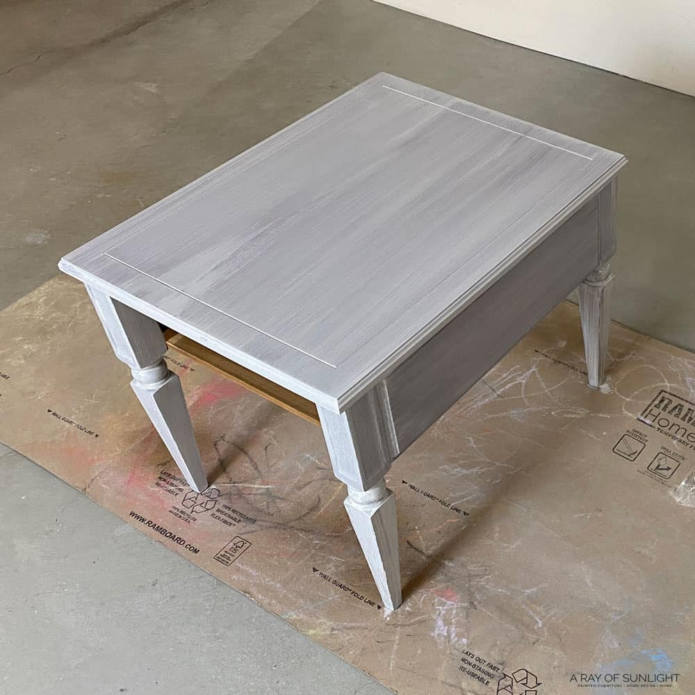 the first coat of paint on the end table looks very streaky