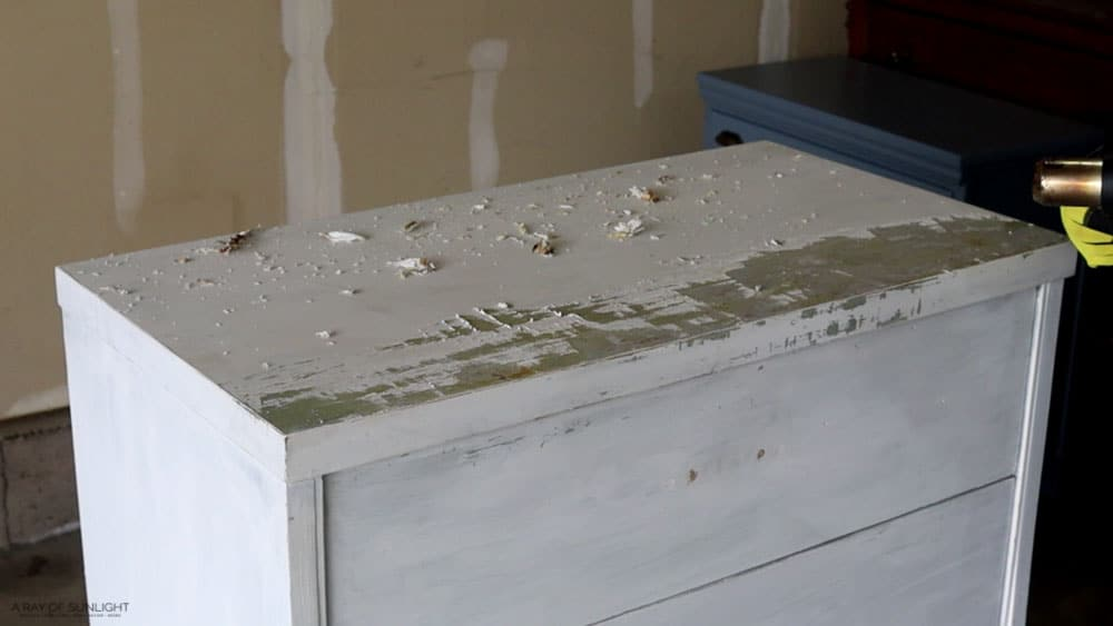 1/4 of the paint removed from dresser top