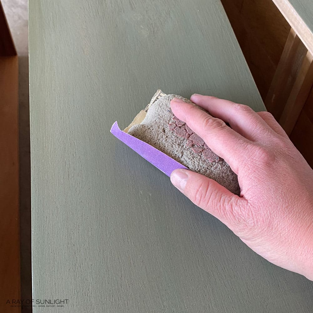 sanding fusion mineral paint with 220 grit sandpaper in between coats of paint