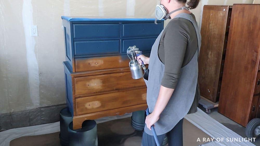 spraying a dresser blue with the fuji q4 sprayer
