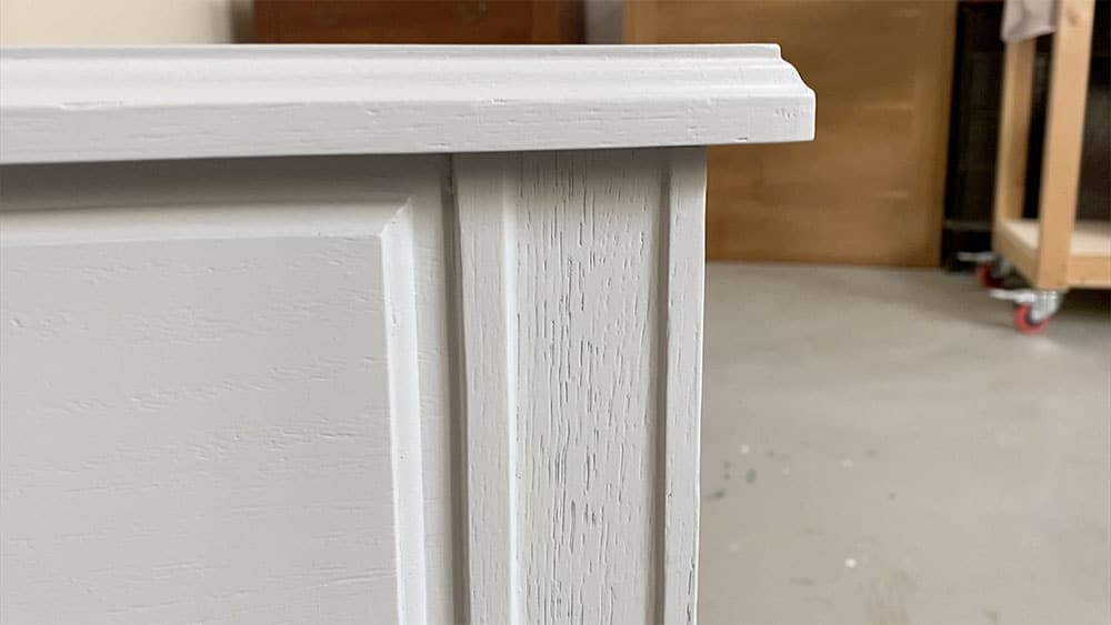 Wood grain showing on painted furniture